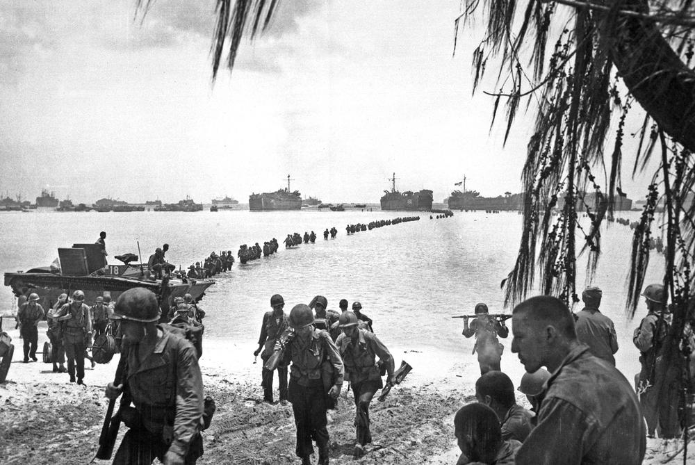Allied invasion force landing on the beaches of Saipan in the Mariana Islands in the summer of 1944. (credit: Laudansky/NARA FILE # 111-SC-191475 War and Conflict Book # 1168)