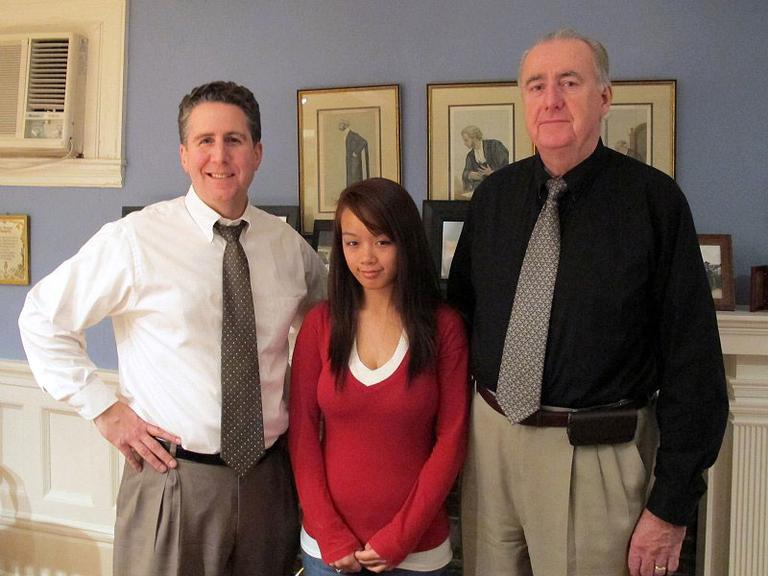 "Nga Truong, with lawyers Jeff Richards, left, and Ed Ryan, on Monday. Ryan has called Truong's 2008 interrogation by Worcester police ""psychological torture."" (Lisa Tobin/WBUR)"