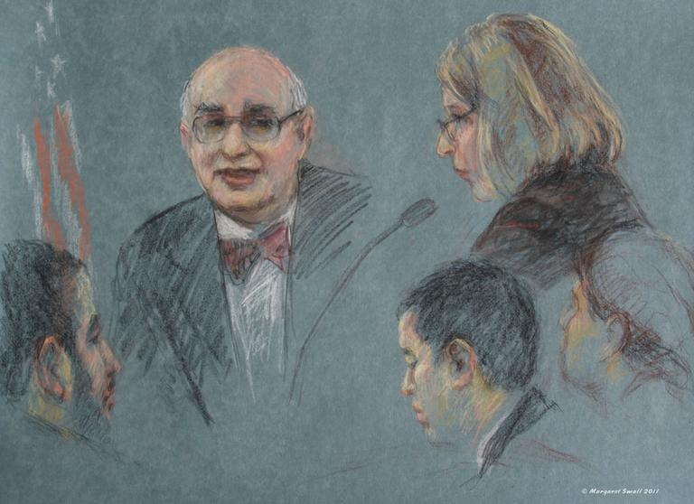 Dr. Marc Sageman, center, a terrorism consultant and former CIA case agent, testifies as defense attorney Janice Bassil, right, asks questions. Defendant Tarek Mehanna is at left; Bassil's aides are at right. (Margaret Small)