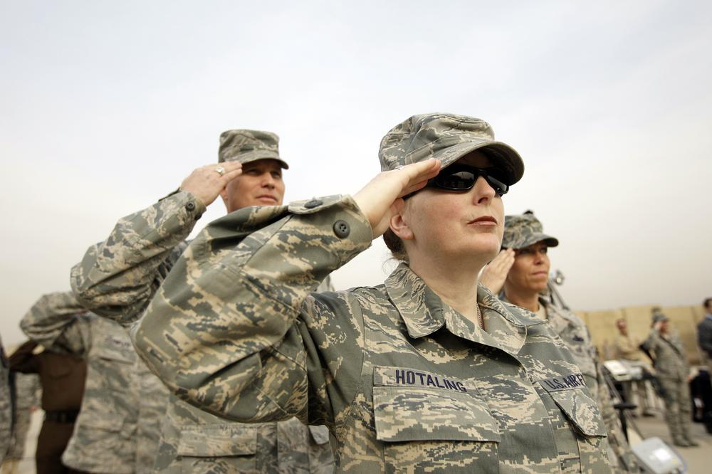 US Army soldiers salute during ceremonies marking the end of US military mission in Baghdad, Iraq, Thursday. (AP)