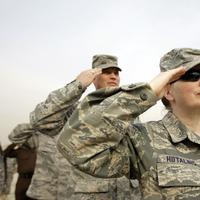 US Army soldiers salute during ceremonies marking the end of US military mission in Baghdad, Iraq, Thursday, Dec. 15, 2011. After nearly nine years, 4,500 American dead, 32,000 wounded and more than $800 billion, U.S. officials formally shut down the war in Iraq a conflict that U.S. Defense Secretary Leon Panetta said was worth the price in blood and money, as it set Iraq on a path to democracy. (AP Photo/Khalid Mohammed)