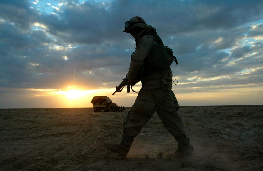 A soldier with A Company 3rd Battalion 7th Infantry Regiment walks through the desert near Karbala in central Iraq in 2003. (AP)
