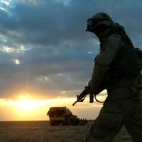 A soldier with A Company 3rd Battalion 7th Infantry Regiment, part of the 3rd Infantry Division, walks through the desert near Karbala in central Iraq in 2003. (AP)