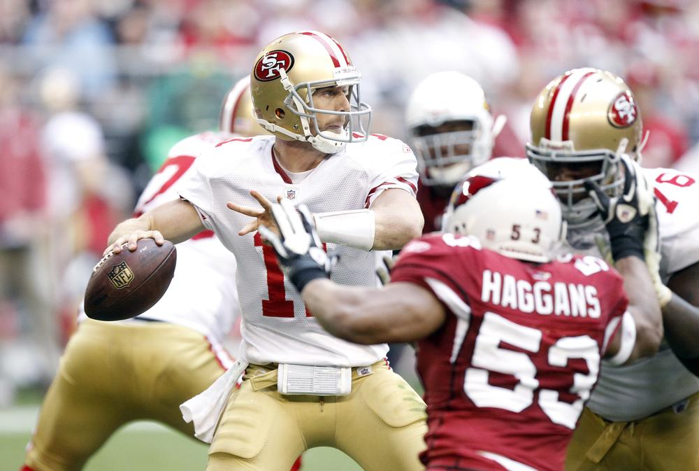 San Francisco 49ers' Alex Smith attempts to complete a pass against the Arizona Cardinals on Sunday in Glendale, Ariz. The 49ers gave up a 12-point lead, losing the game 21-19. (AP)