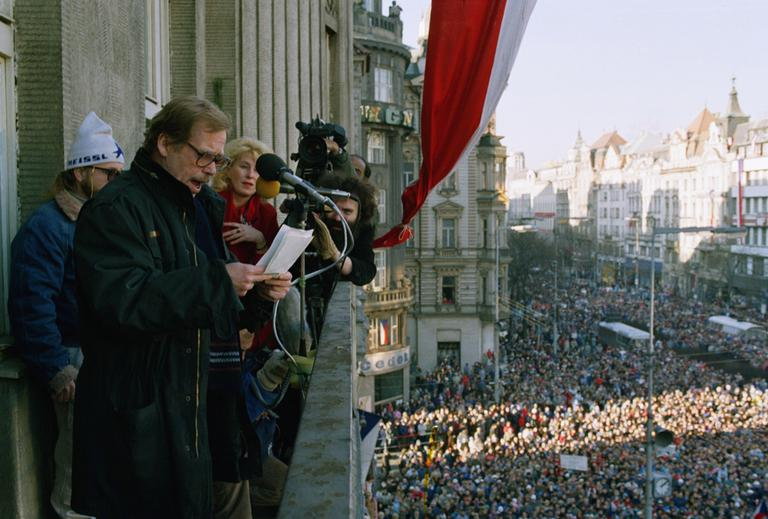 Vaclav Havel, nominated for the Presidency reads out the names of Czechoslovakia's first non-communist Government since 1948. Thousands of people gathered on Sunday, Dec. 10, 1989 in Prague's Wenceslas Square to bare witness to the success of their peaceful revolution. (AP)