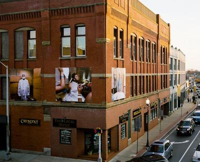 Meehan's portraits hang from a building at 214 Main Street in Brockton, Mass. (Courtesy of Mary Beth Meehan)