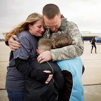 Lincoln resident Tami Nordman and her children James, Jr. and Hope are hugged by Nebraska Army National Guard Sgt. James Nordman after returning home with members of his unit, Company C, 2-135th General Support Aviation Battalion, at the National Guard air base in Lincoln, Neb. on Saturday morning, November 19, 2011. Ninety members of the unit arrived home to be greeted by hundreds of family members and friends after a nearly year-long mission to Iraq. (FRANCIS GARDLER / Lincoln Journal Star)