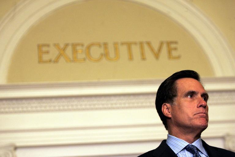 Then-Gov. Mitt Romney speaks to reporters in front of his office at the State House in Boston on July 27, 2006, about the resignation of Mass. Turnpike Authority chairman Matt Amorello after a ceiling panel killed a motorist in a Big Dig highway tunnel. (AP)