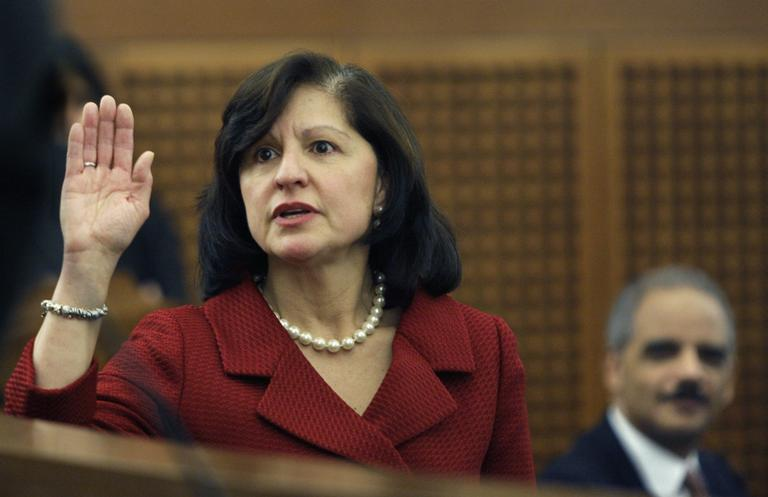 U.S. Attorney General Eric Holder, right, watches as the new U.S. Attorney for Massachusetts Carmen Ortiz is sworn in during her installation ceremony at the federal courthouse in Boston Monday, Jan. 11, 2010. (AP)