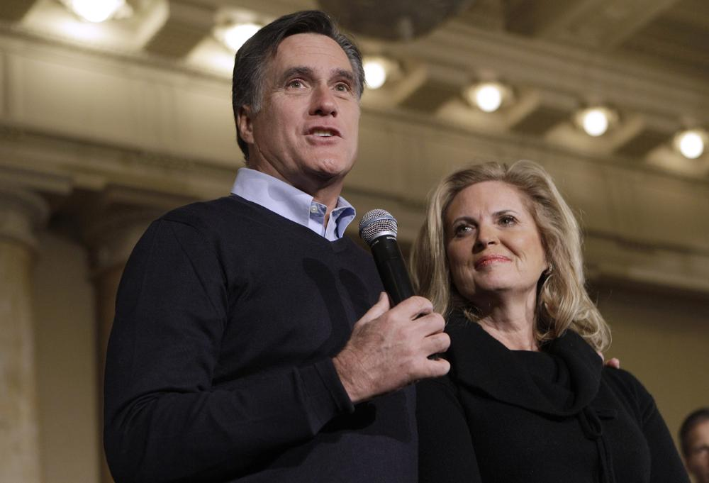 Republican presidential candidate, former Massachusetts Gov. Mitt Romney, accompanied by his wife Ann, speaks during a caucus day rally at the Temple for Performing Arts, in Des Moines, Iowa. (AP)
