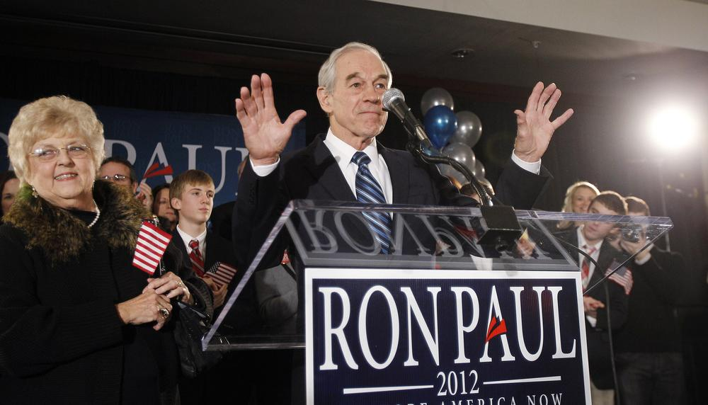 Republican presidential candidate Rep. Ron Paul, R-Texas, tries to quiet the crowd at his caucus night rally, Tuesday in Ankeny, Iowa. (AP)