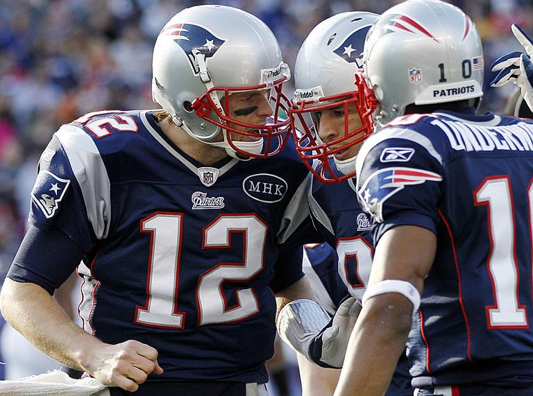 Tom Brady celebrates a touchdown by tight end Aaron Hernandez during the second quarter of an NFL game against the Buffalo Bills. (AP Photo/Elise Amendola)