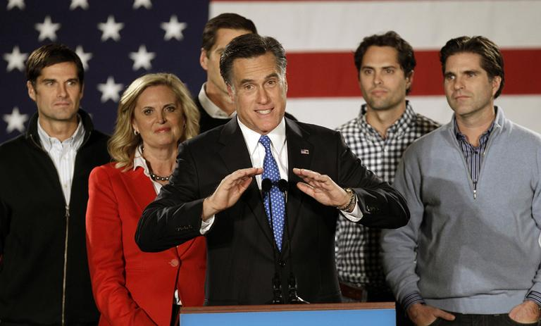 GOP presidential candidate Gov. Mitt Romney addresses supports with his family. (AP)