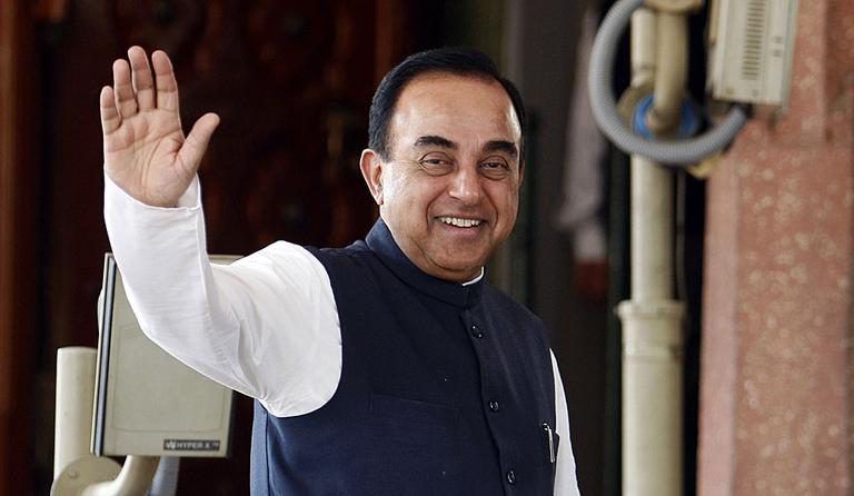 Subramanian Swamy gestures to the media as he enters the Indian Parliament in 2010. (AP Photo/ Mustafa Quraishi)