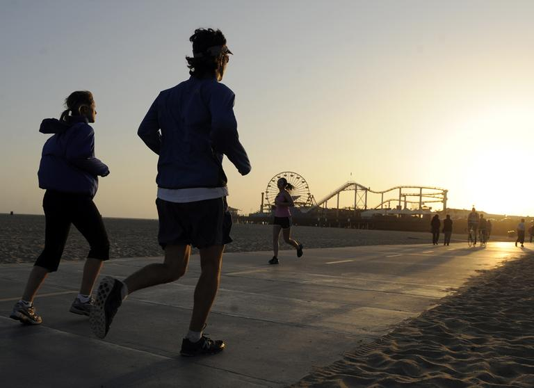 """In this May 23, 2011 photo, joggers make their way down Santa Monica Bike Path, in Santa Monica, Calif. Despite all the """"Biggest Loser"""" type shows, all the pounds shed on those shows and all the weight-loss products purchased by viewers at home, America continues to be the Biggest Gainer. (AP)"""