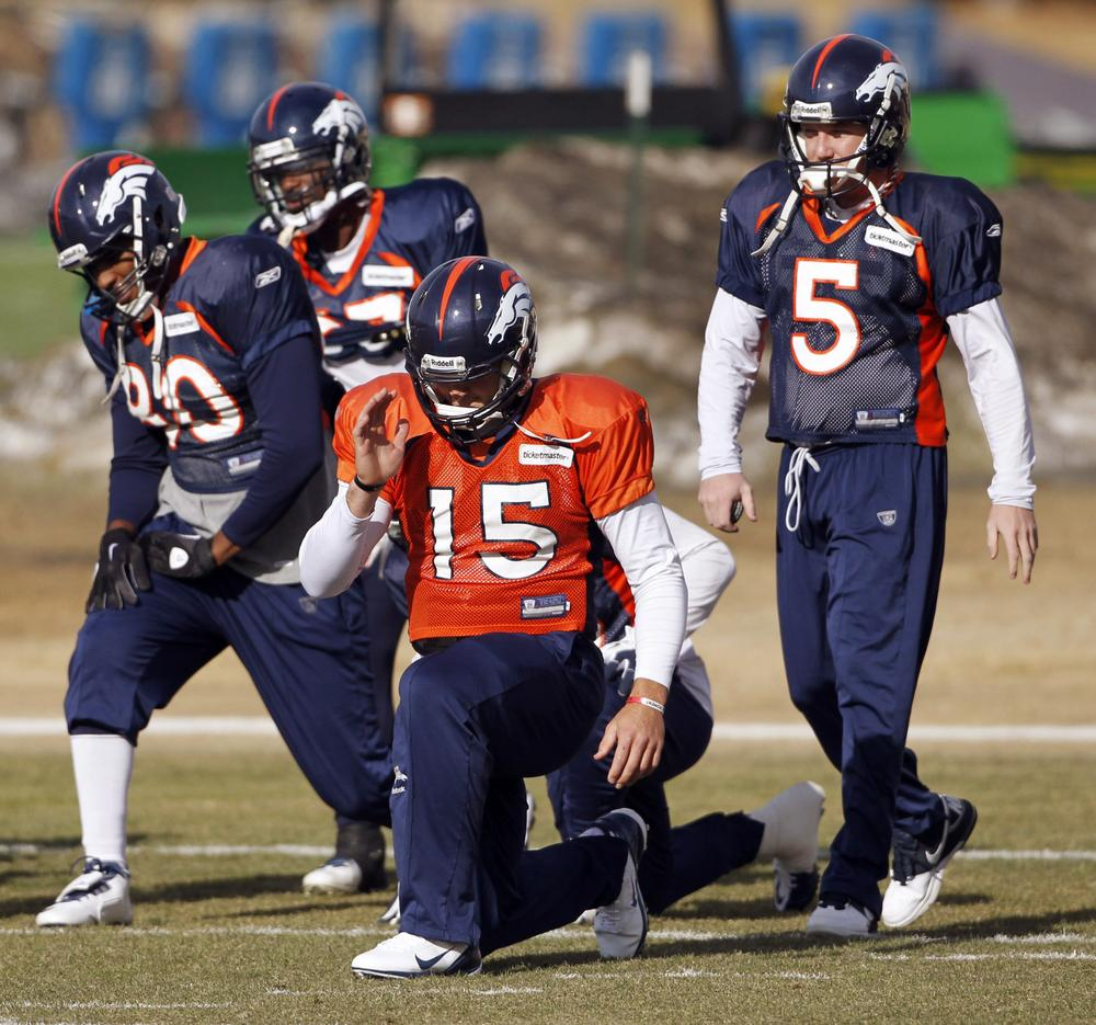 Denver Broncos quarterback Tim Tebow (15) stretches with teammates during NFL football practice in Englewood, Colo., on Wednesday. The Broncos are scheduled to host the Pittsburgh Steelers on Sunday in a wild-card playoff game. (AP)