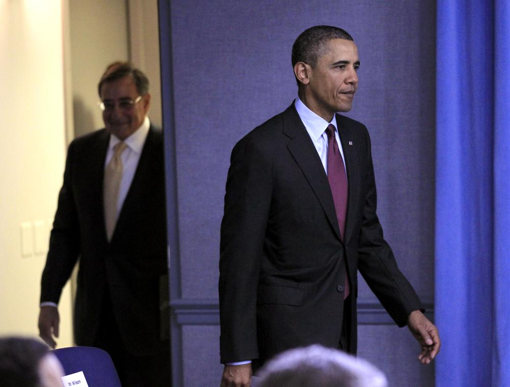 President Barack Obama, followed by Defense Secretary Leon Panetta arrive for a news briefing on the defense strategic guidance at the Pentagon, Thursday. (AP)