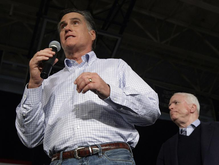 Former Massachusetts Gov. Mitt Romney, left, campaigns with Sen. John McCain, R-Ariz., during a town hall style meeting in Manchester, N.H., on Wednesday. (AP)