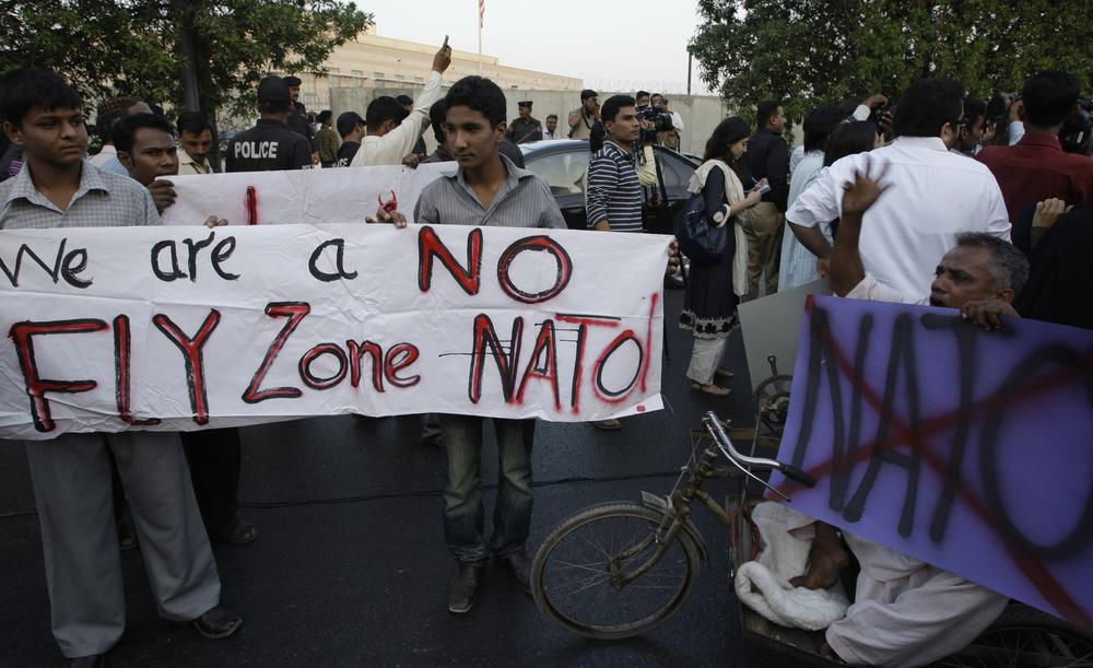 Pakistani university students protest against the NATO airstrikes on Pakistani troops, outside the U. S. consulate in Karachi, Pakistan in December. (AP)