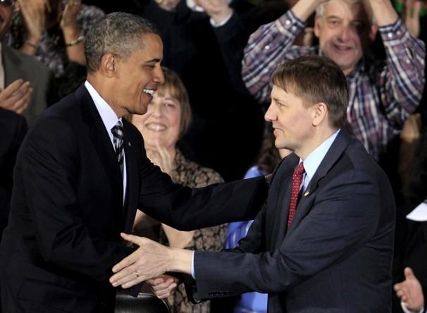 President Obama shakes hands with Richard Cordray at Shaker Heights High School, in Shaker Heights, Ohio, on Wednesday. (AP)