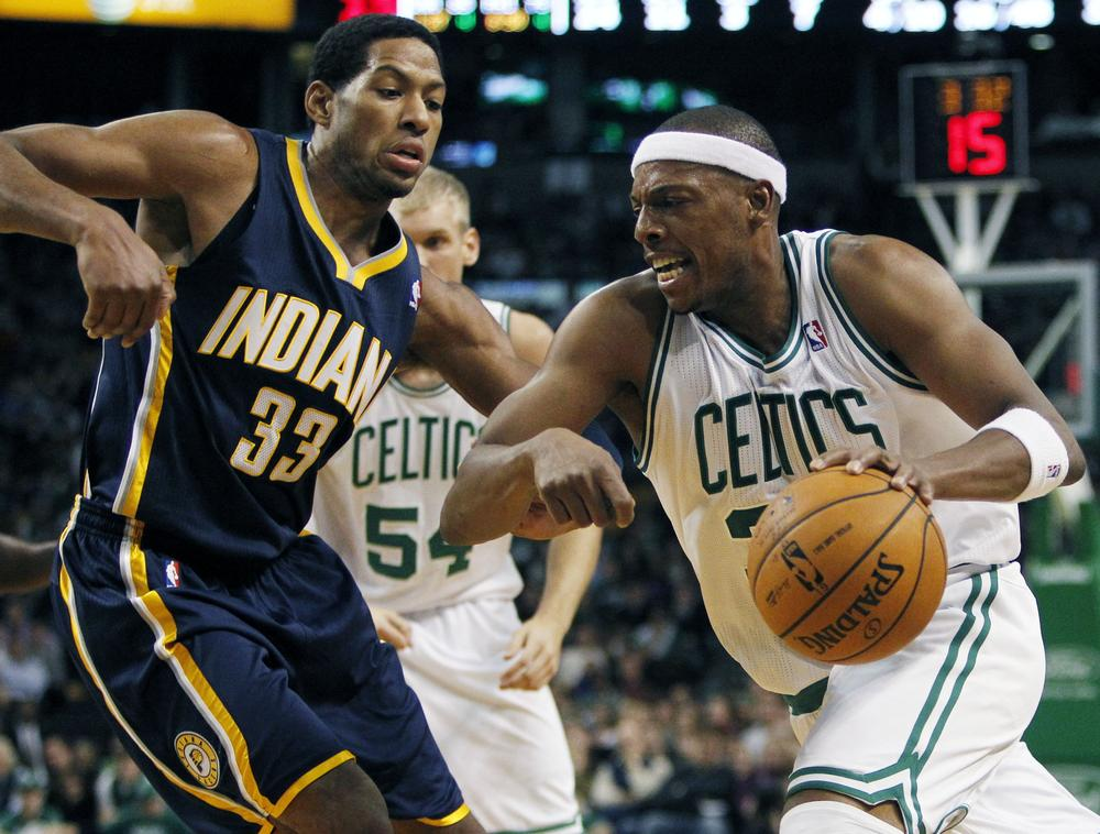 Paul Pierce, right, drives past Indiana Pacers' Danny Granger in the third quarter of the game last night. The Pacers won 87-74.