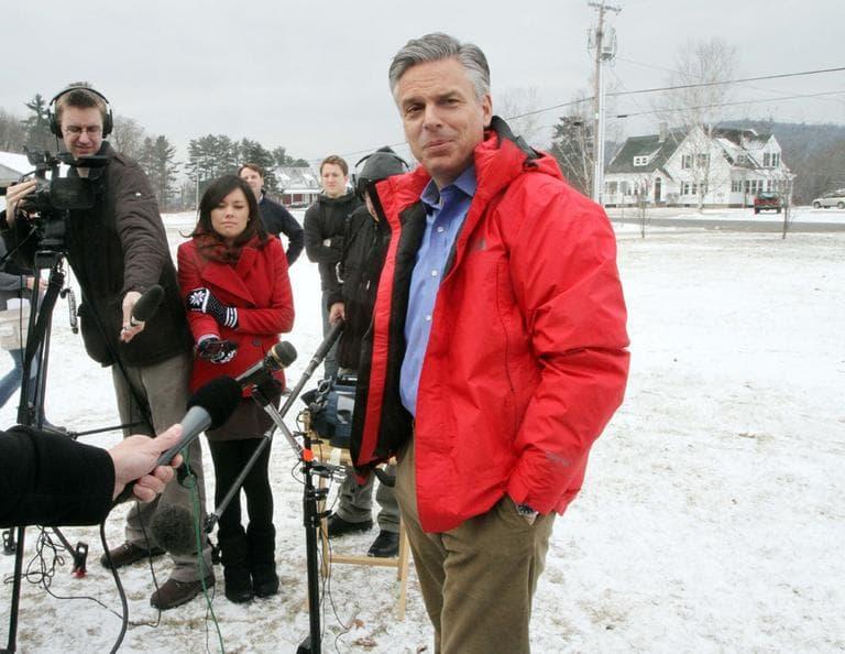 Republican presidential candidate, former Utah Gov. Jon Huntsman, talks to reporters on Saturday in North Haverhill, N.H.