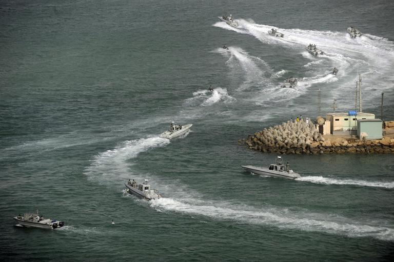 Iranian navy speed boats attend a drill in the sea of Oman, on Friday, Dec. 30, 2011. Iran's navy chief has reiterated for a second time in less than a week that his country can easily close the strategic Strait of Hormuz at the mouth of the Persian Gulf, the passageway through which a sixth of the world's oil flows. (AP)