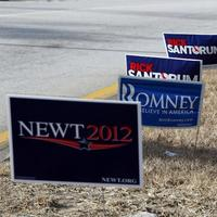 Signs from various candidates are seen planted on a grass covered median on Thursday  in Manchester, N.H..