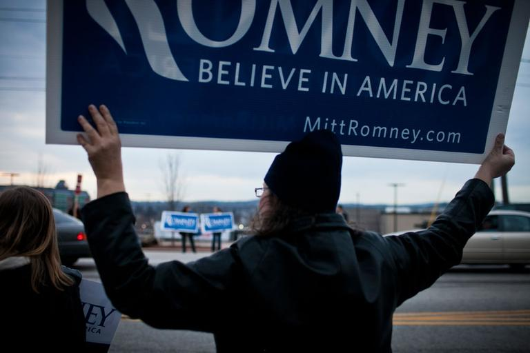 A standout outside Mitt Romney's campaign headquarters in Manchester, N.H., Saturday (Dominick Reuter for WBUR)