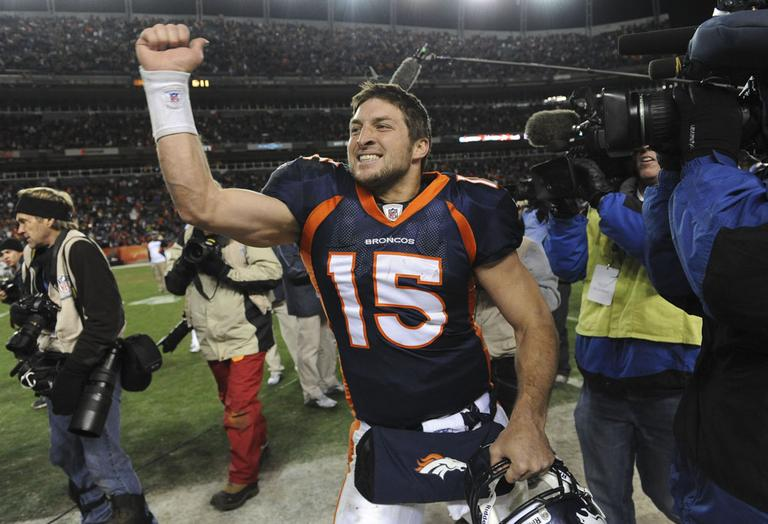 Denver Broncos quarterback Tim Tebow celebrates after beating the Steelers 29-23 in overtime of an NFL wild card playoff football game Sunday. (AP)