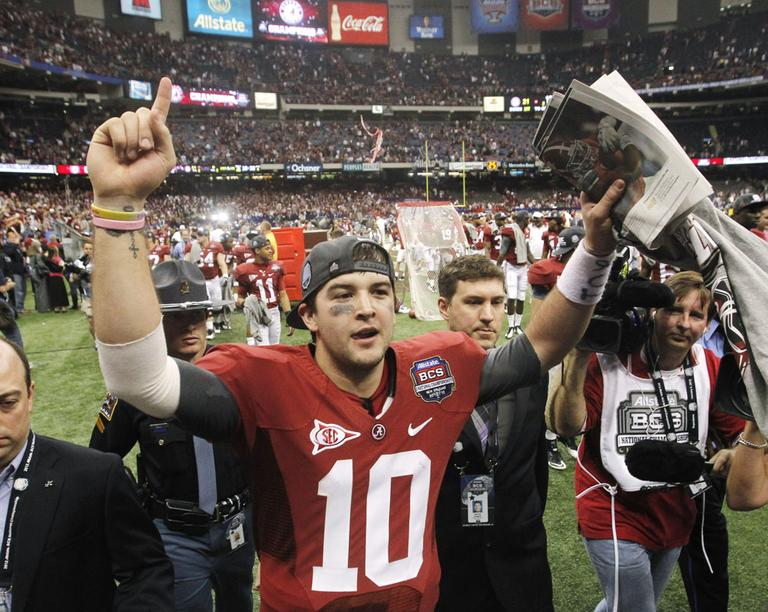 Alabama's AJ McCarron celebrates after the BCS National Championship college football game against LSU Monday. (AP)