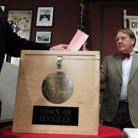 A voter casts his early morning ballot in Dixville Notch, N.H. (AP)
