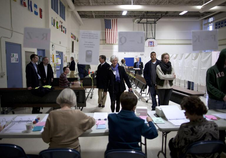 Voters arrive to cast ballots at the Webster School in Manchester, N.H. on Tuesday. (AP)