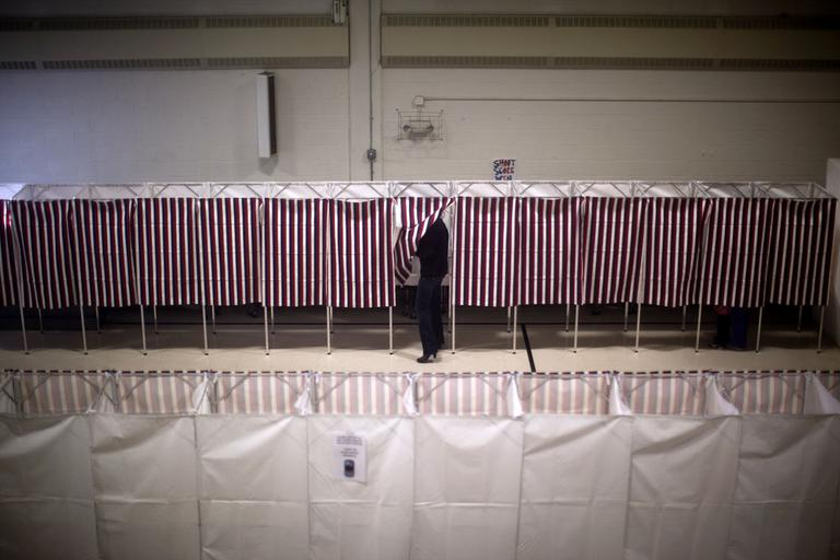 Voters cast ballots in the gym of the Webster School in Manchester, N.H., on Tuesday. (AP)