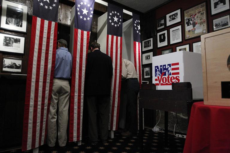 Residents get ready to mark their ballots in Dixville, N.H late Monday night. (AP)