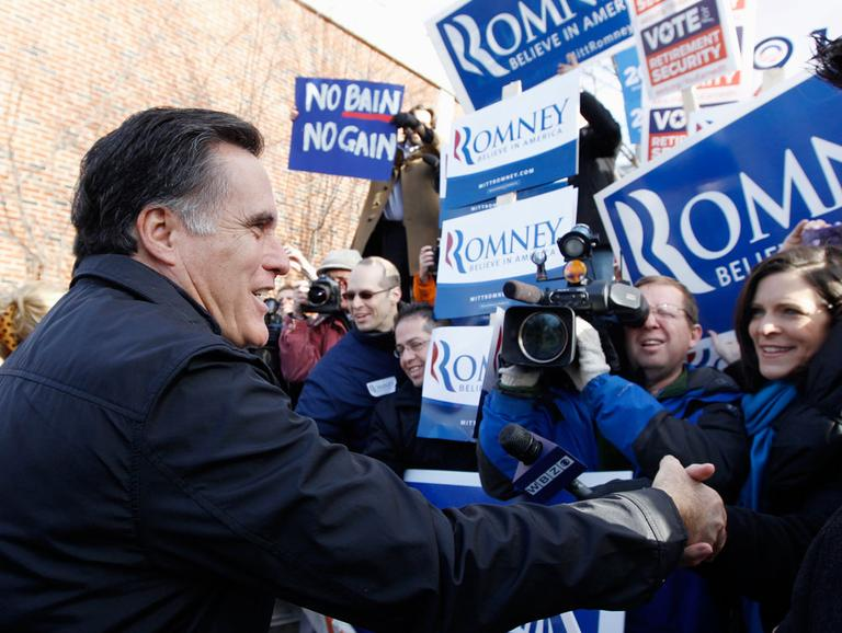 Mitt Romney visits a polling station in Manchester, N.H., Tuesday. (AP)