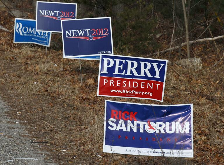Campaign signs line a road in Derry, N.H on Tuesday. (AP)