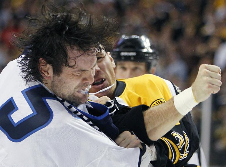 Boston Bruins' Shawn Thornton, rear, lands a punch on Winnipeg Jets' Mark Stuart (5) in the second period of an NHL hockey game in Boston, Tuesday. (AP)