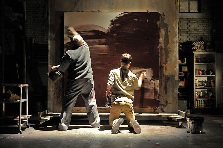 "Thomas Derrah (left) as artist Mark Rothko and Karl Baker Olson (right, foreground) as his assistant Ken in a scene from the SpeakEasy Stage Company production of ""Red."" (Photo:  Craig Bailey/Perspective Photo)"