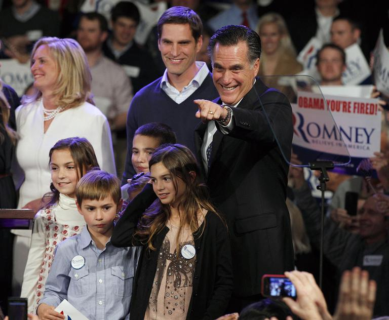 Former Massachusetts Gov. Mitt Romney surrounded by his family points towards supporters at the Romney for President New Hampshire primary night victory party at Southern New Hampshire University in Manchester, N.H., Tuesday, Jan. 10, 2012. (AP)