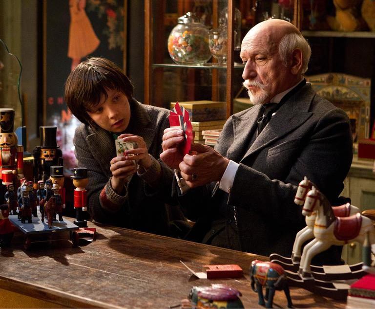 """In this image released by Paramount Pictures, Asa Butterfield portrays Hugo Cabret, left, and Ben Kingsley plays Georges Méliès in a scene from """"Hugo."""" (AP)"""