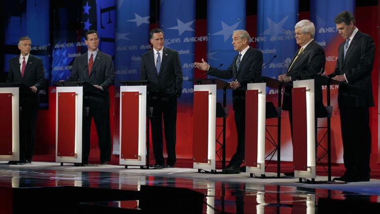 Rep. Ron Paul, R-Texas, center right, answers a question as former Utah Gov. Jon Huntsman, former Pennsylvania Sen. Rick Santorum, former Massachusetts Gov. Mitt Romney, former House Speaker Newt Gingrich and Texas Gov. Rick Perry (L-R) during a Republican presidential candidate debate at the Capitol Center for the Arts in Concord, N.H., Sunday, Jan. 8, 2012. (AP)