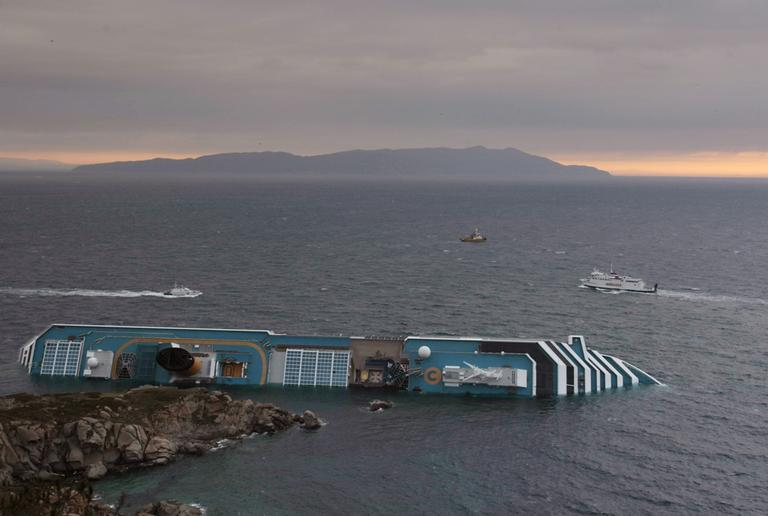 The Costa Concordia cruise liner lies on its side two days after it ran aground off the tiny Tuscan island of Giglio, Italy, Monday, Jan. 16. (AP)