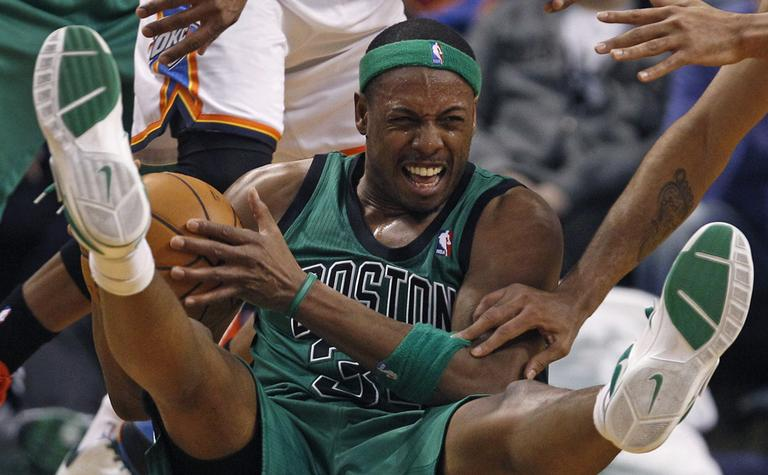 Celtics forward Paul Pierce hits the floor as he is pressured to pass against the Oklahoma City Thunder. (AP)