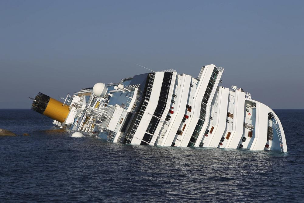 The cruise ship Costa Concordia lies on its side off the tiny Tuscan island of Giglio, Italy. (AP)
