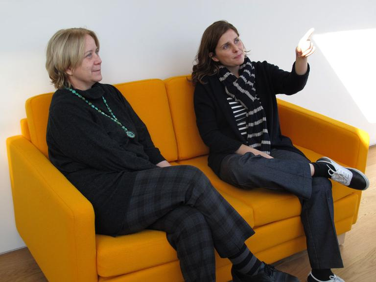 LA-based photographer Luisa Lambri, right, and curator of contemporary art Pieranna Cavalchini in an apartment for artists (Andrea Shea/WBUR)