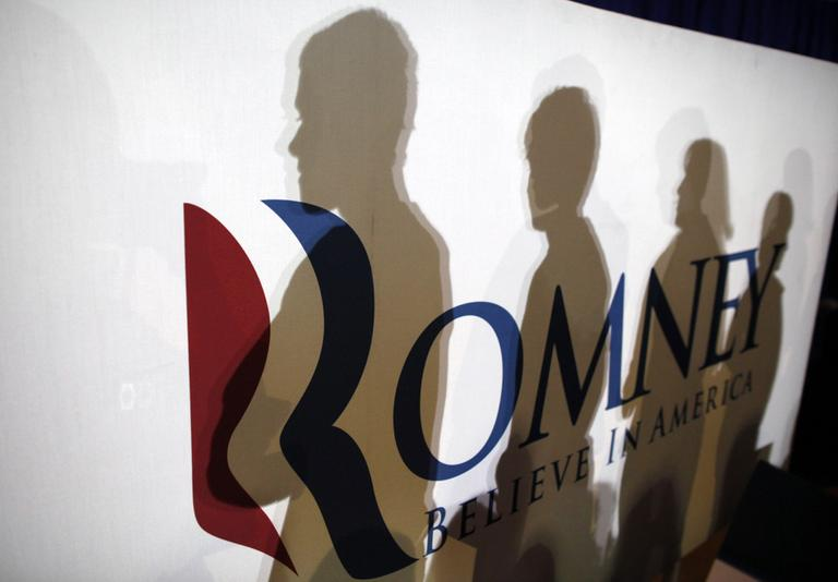 Shadows of audience members are cast on a campaign sign in Irmo, S.C., Wednesday. (AP)