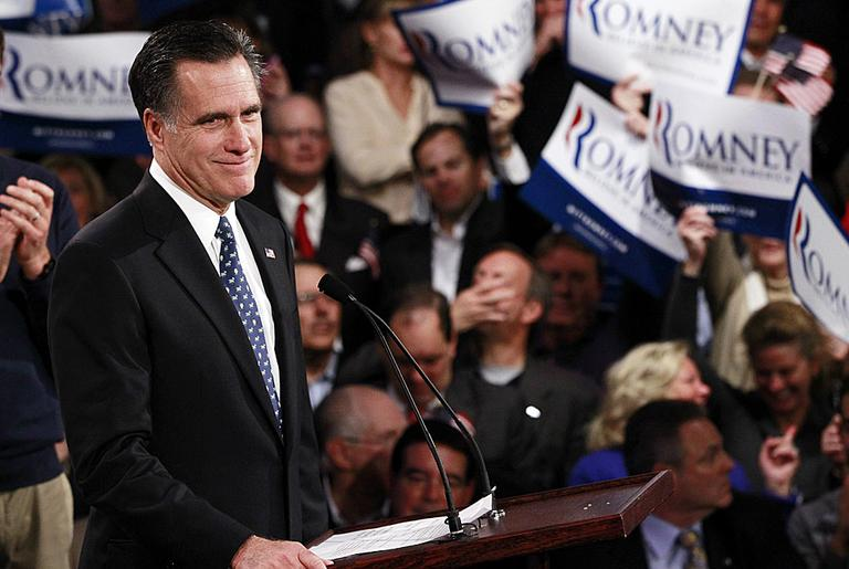 Mitt Romney celebrates his New Hampshire primary election win in Manchester. (AP Photo/Charles Dharapak)