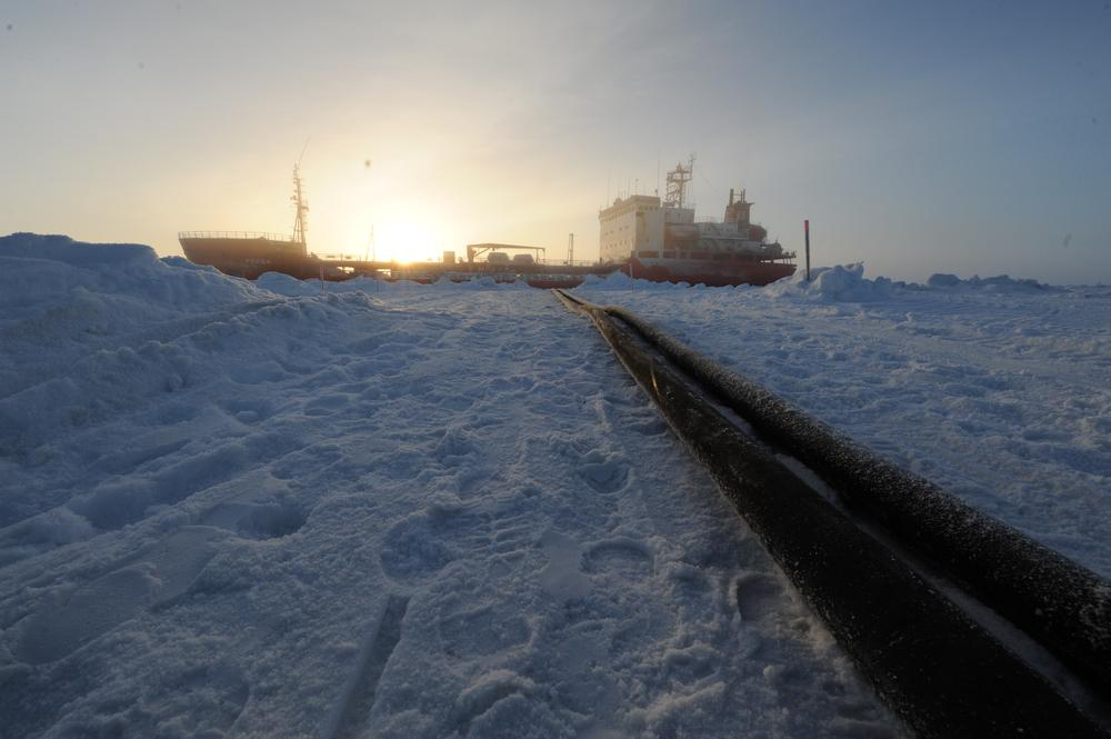 In a photo provided by the U.S. Coast Guard, two hose lines run from the Russian tanker Renda in Nome, Alaska. (AP)