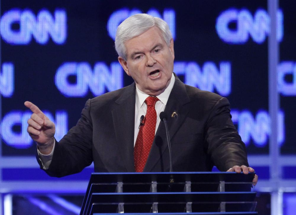 Republican presidential candidate former House Speaker Newt Gingrich is polling nearly even with front runner Mitt Romney, a day after a fiery debate performance. (AP)